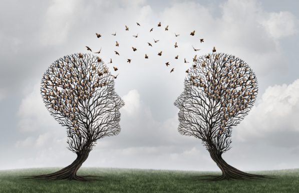 Concept of communication and communicating a message between two head shaped trees with birds perched and flying to each other as a metaphor for teamwork and business or personal relationship with 3D illustration elements.