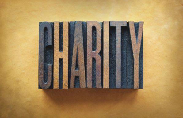 The word CHARITY written in vintage letterpress type.
