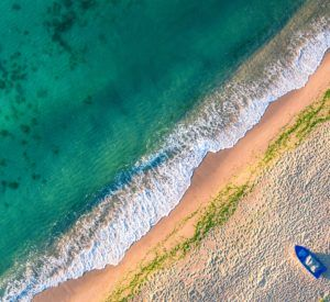 Aerial view of ocean waves and sand on beach